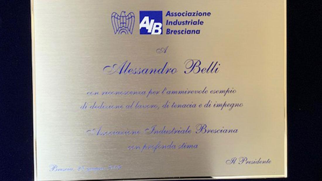 Il Presidente AVE Alessandro Belli premiato dall'AIB